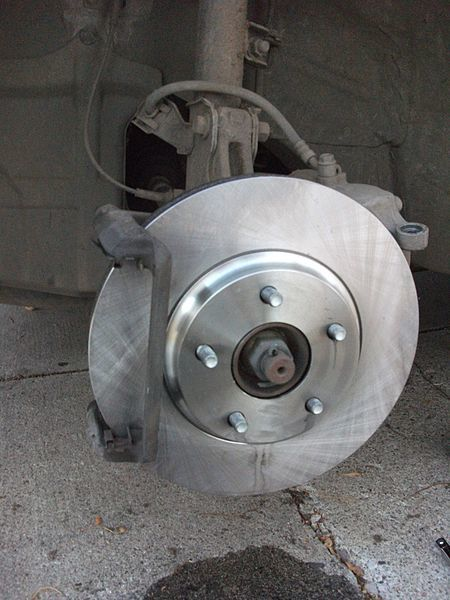 To solve noisy brakes put the new rotor on (clean with brake cleaner fluid first!) then fixed bit of the caliper goes on.