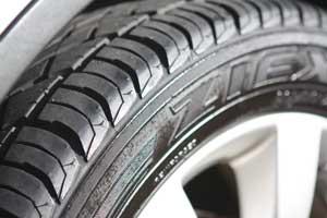 Water-channeling tire tread