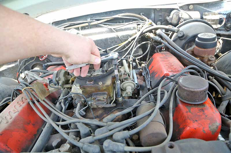 The old car was unbolted and disconnected from the intake manifold. Make sure that all of the fasteners and pieces are kept, they will be reused.