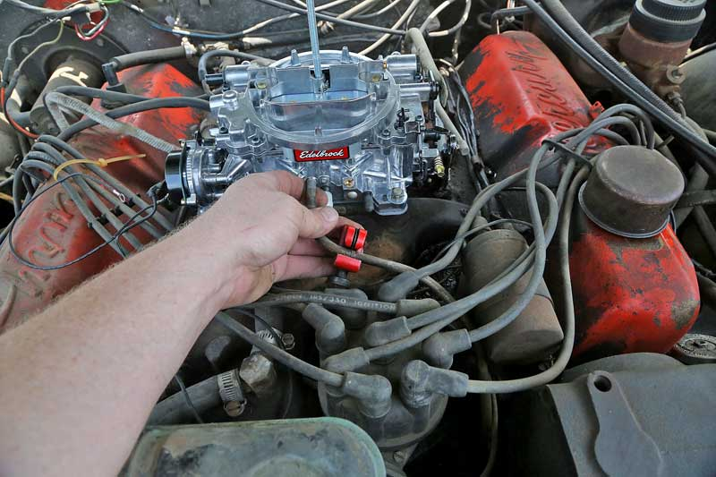 """After threading in the required vacuum fittings, the carburetor was mounted. In this case, we needed to alter the fuel line. We simply cut and flared the end to accept a piece of 5/16"""" fuel hose."""