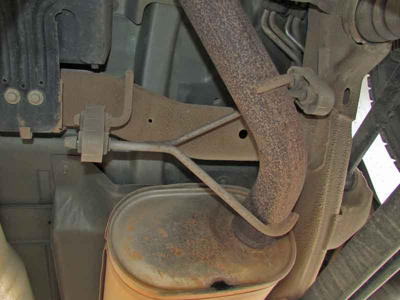 The exhaust has quite a few hangers. The muffler is heavy, be careful when removing the hangers.
