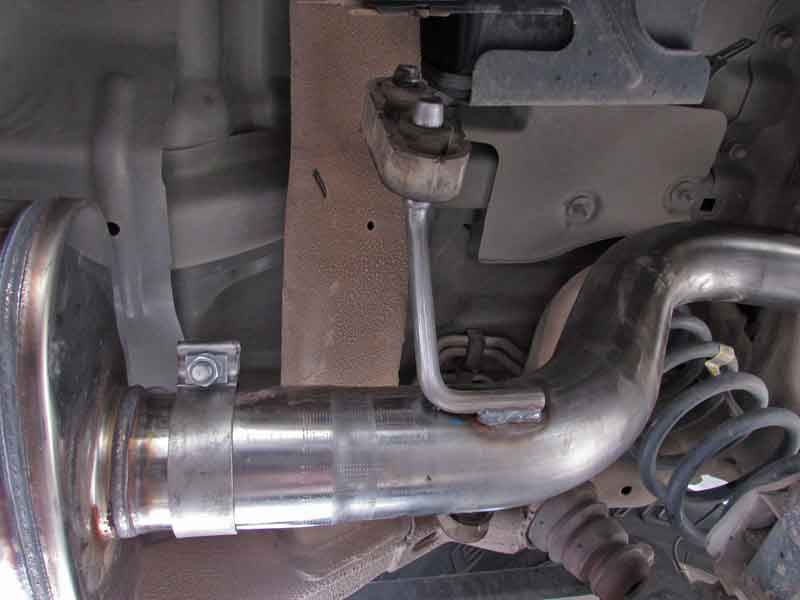 The next pipe is the piece that goes over the rear axle. route it over the axle, and slip the pipe over the muffler outlet. Don't forget the clamp!