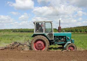 A tractor plowing a field on a farm.