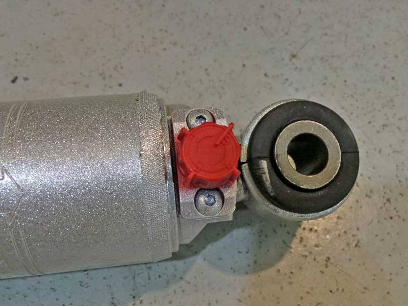 The red knob allows you to adjust the damping effect of the shock, more or less, giving you the control.