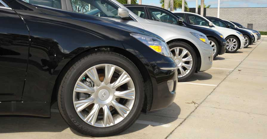 Row of cars for sale at dealership