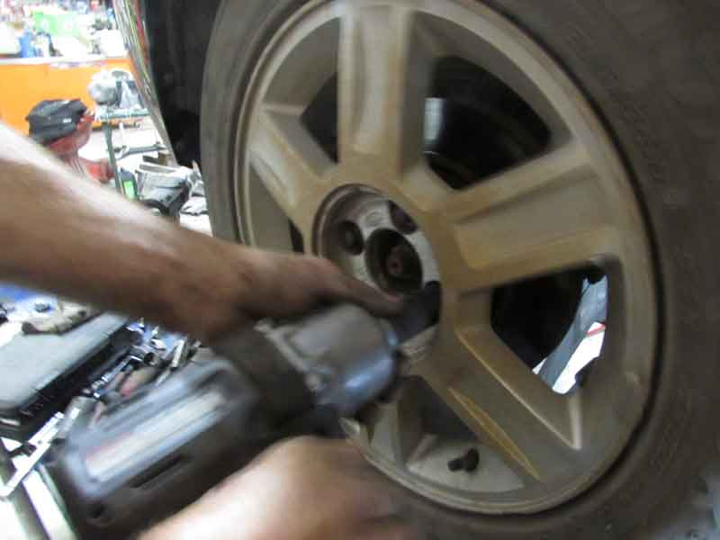 Never support a vehicle with just a jack, always just jackstands. Once safe, remove the wheel.