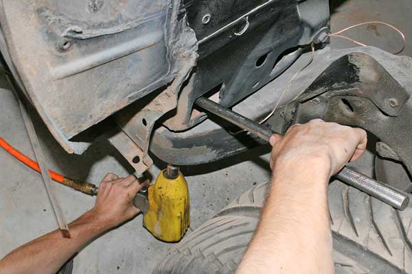 The installation process is invasive, getting to all the bolts can be difficult, and there are usually some hidden mounts, like these front bushings, which require removing the front fenders.