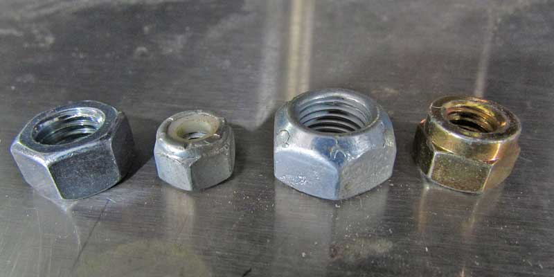 There are different nuts for different uses as well. left to right- standard grade 5, Nylock, torque lock (2 styles).