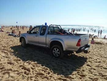 Pickup truck on beach