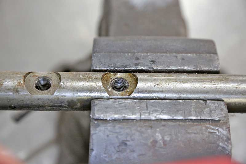 The threads on this rack and pinion has been damaged. This is a repair item, and we will use a tap to clean it up.