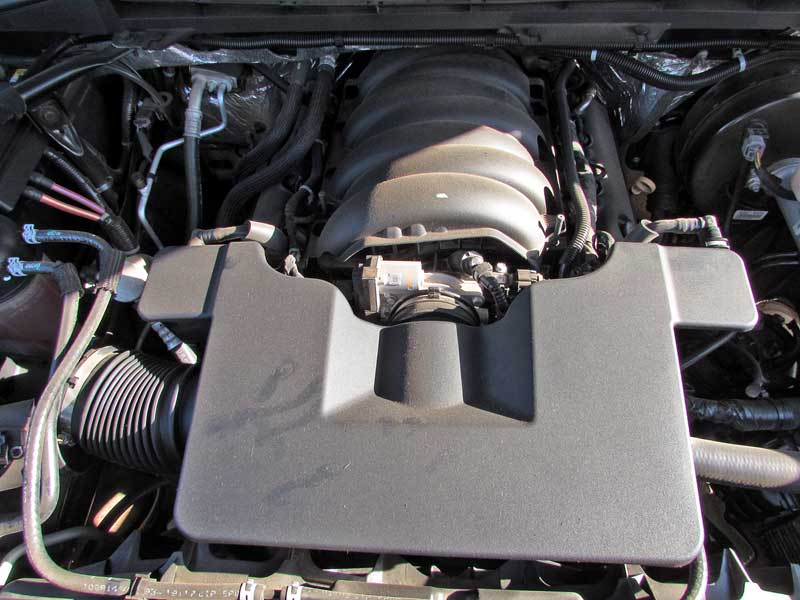 Under this large plastic intake box lies the throttle body. You need to access this.
