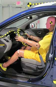 Crash test dummy in a 2010 Hyundai Tucson GLS at the Insurance Institute for Highway Safety Vehicle Research Center.