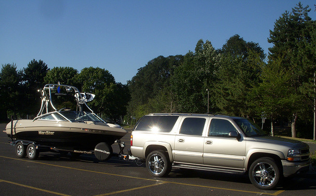 an SUV towing a boat