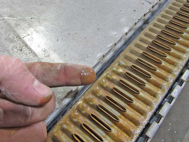 The core is the assembly of cooling tubes and fins. This single-row aluminum core has a fair amount of grit build up, this radiator needed to be flushed more often. The oval openings are where the coolant enters the tubes.