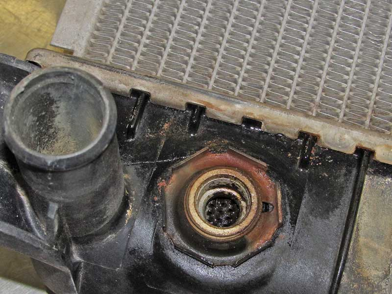The crack is about two inches long, running through the edge of the fitting. This is a common issue for radiators with plastic tanks.