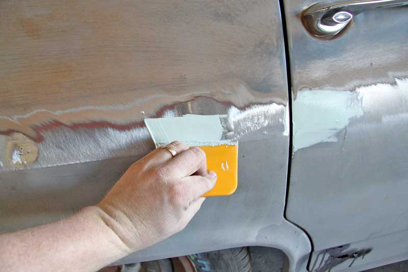 Now you can move on to the filler work. Wipe each repair with a bit of body filler and let it cure.