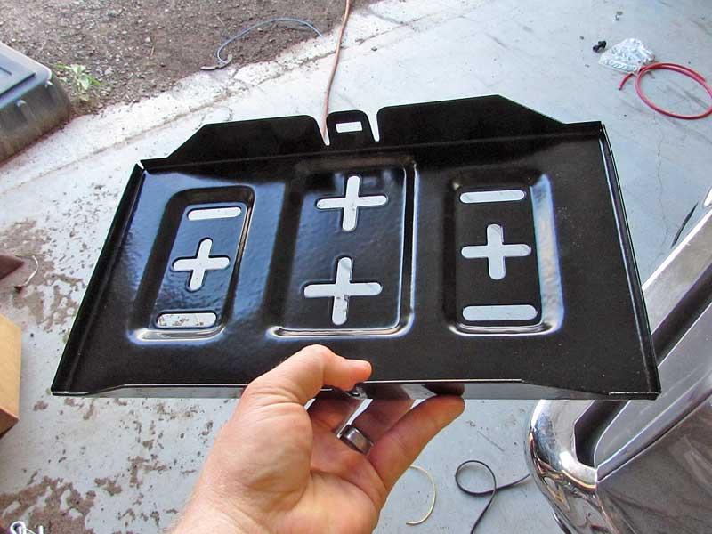 NAPA battery trays are quite nice, especially for a universal part. The powder coating will help it last many years.