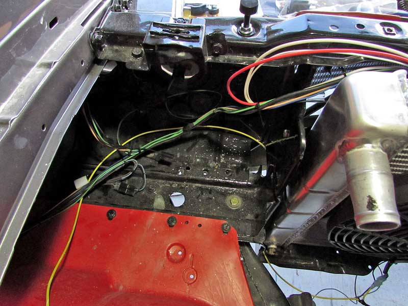 The 1971 Oldsmobile 442 we are working on did not have a tray at all, this is common on fresh restorations after the rust has been repaired. We selected the 3 bolts along the inner fender to secure the tray.