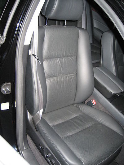 This is the leather seat from the front-passenger side of a 2007 Acura RL. It is trimmed in soft leather and has perforations for heat dispersal and enhanced comfort over long trips.