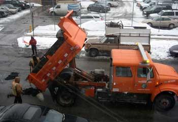 filling a pothole