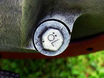 an oil drain plug under a car