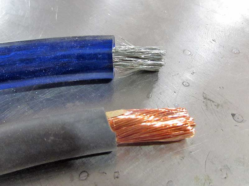 The top wire is aluminum, the bottom is OFC copper. There is a big difference in performance.