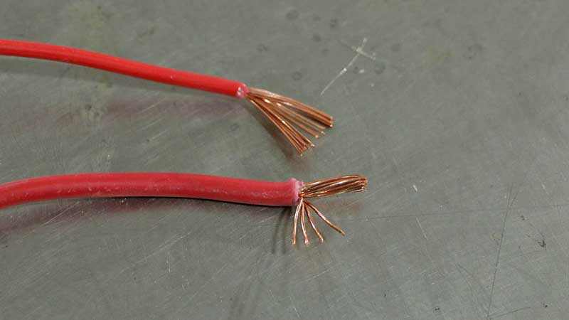 While this is not solid core wire, it is dang close.The top wires is a smaller gauge,but notice how the bottom wire has less than half as many strands? That is cheap wire that does not bend well and is not as good as the higher-strand wire above it.