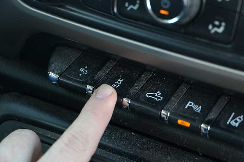 The traction control button can be hard to find, make sure you and your child know where it is.