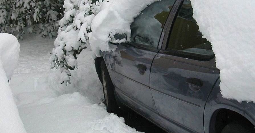 A parked car covered in snow