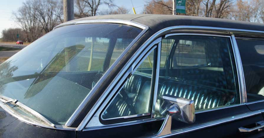 The windshield and side windows on a 1966 Lincoln Continental.