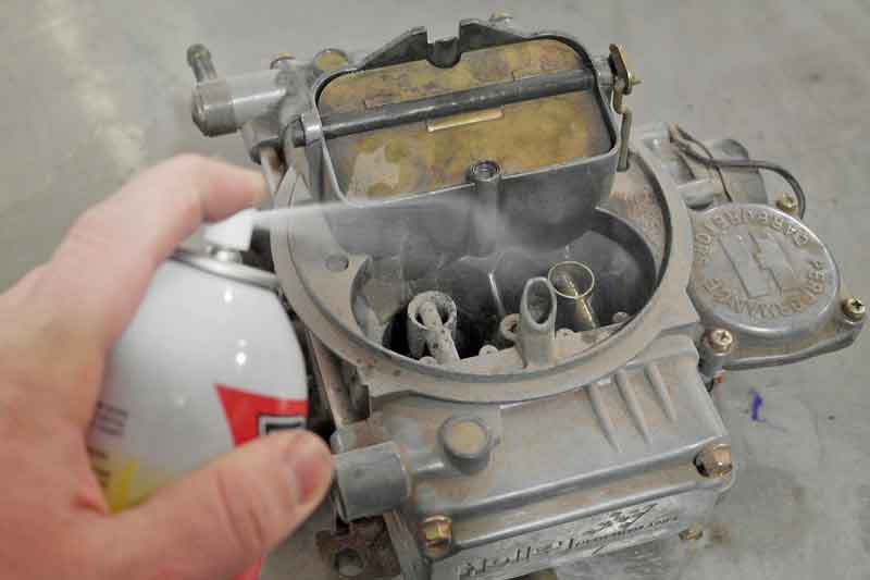 To show how easily it works, we sprayed some carb cleaner on this old Holley carb.