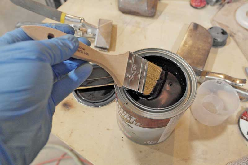 We used a chip brush to apply the paint. Make sure the temperature is about 65 degrees, otherwise you could have adhesion issues.
