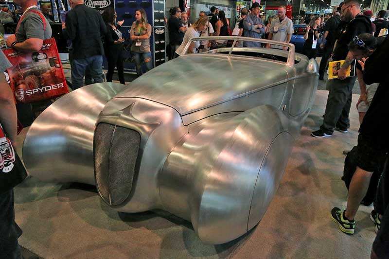 This may be one of the most beautiful cars ever built. Built by Rick Dore, this project is just that- an unfinished project, shown at SEMA in raw aluminum.