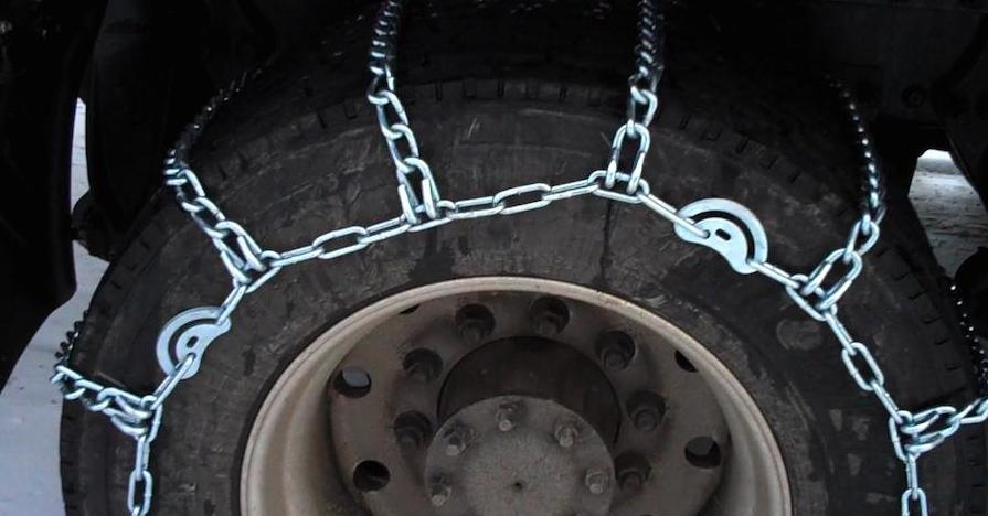 A tire outfitted with tire chains.
