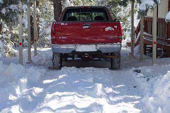 Pickup truck in a snowy driveway