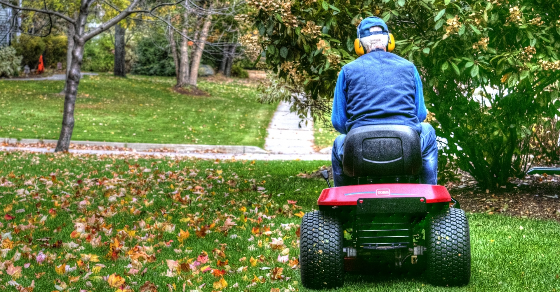A Man Riding Lawn Mower With New Battery