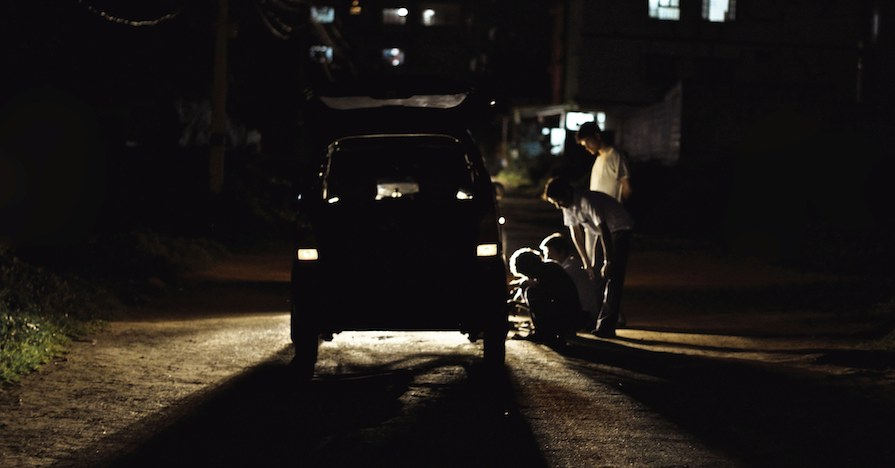 Motorists stranded on the roadside inspecting their vehicle – this could be the result of overlooked car maintenance.