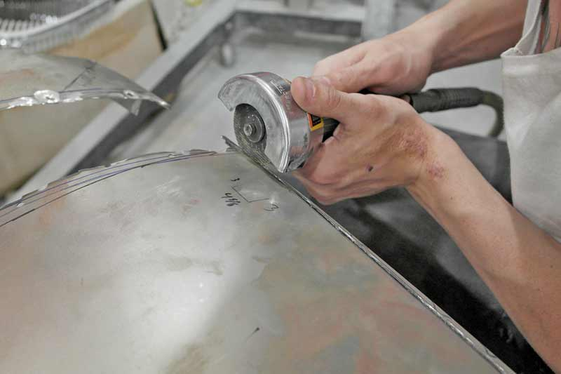 Cut-off tools are essentially a die grinder with a hooded wheel. The hood protects the user from sparks and flying debris.