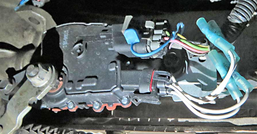 A neutral safety switch is pictured in a car.
