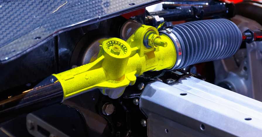 The steering gear on an Alfa Romero automobile, featuring a rack and pinion setup.