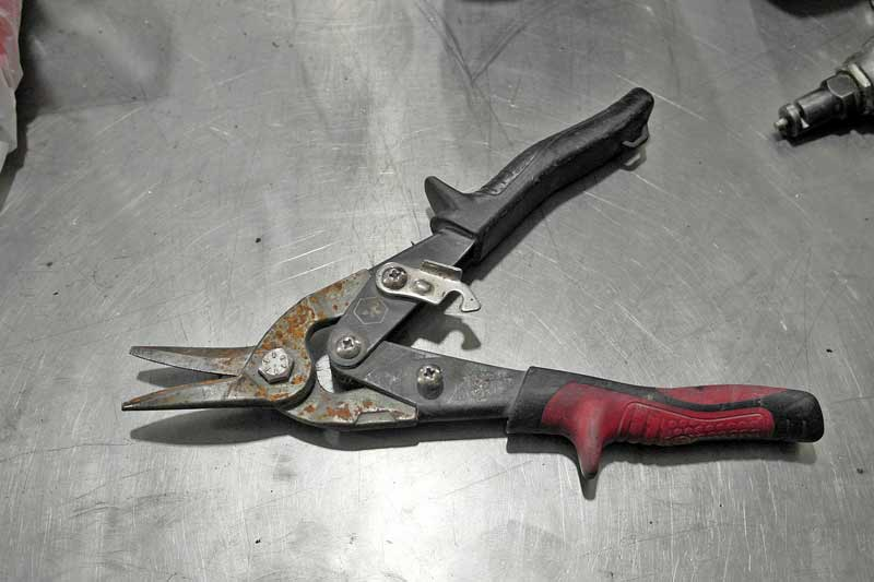 The standard tin snips comes in three standard cuts, and you should have all three on hand. They are great for making small cuts