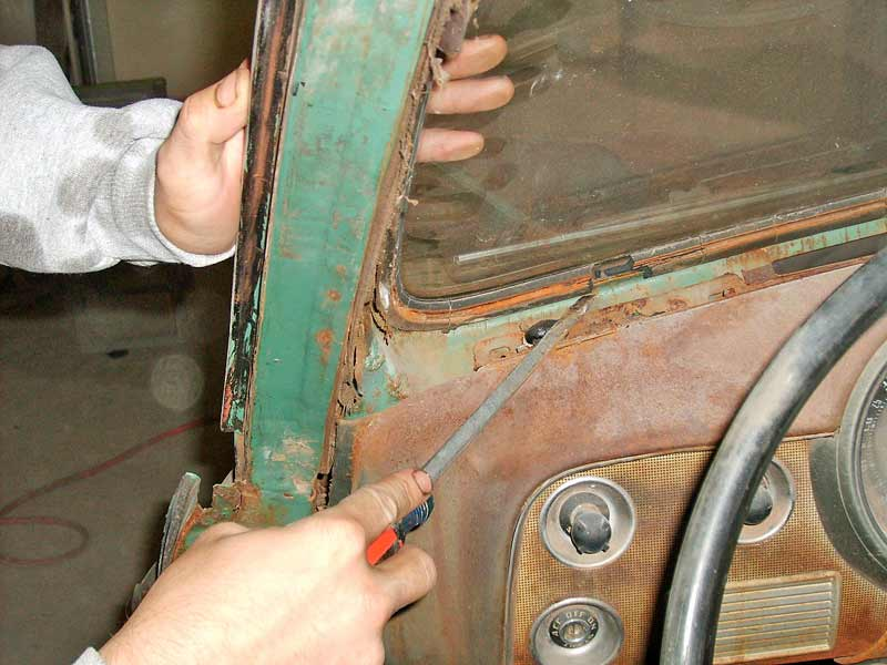 The older the rubber, the harder it is to cut, as this vehicle required using a screwdriver to break the hardened rubber away.
