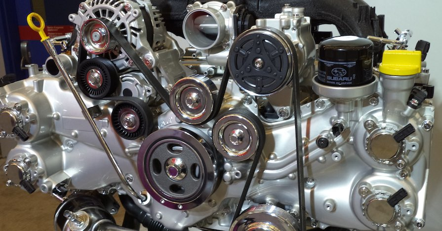 A late-model Subaru boxer engine has been removed from the vehicle.