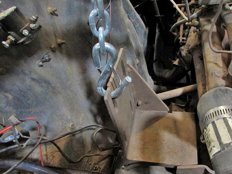 If your engine has a hook like this one (technically this is an old style AC bracket), you can use it as a pick point.