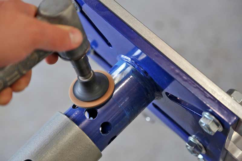 We used a coarse Scotch-Brite™ pad on a die grinder to remove as much of the coating as possible.