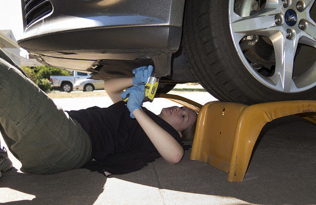 a person doing DIY car maintenance