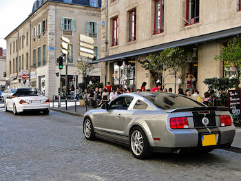 A new Ford Mustang pulled over on the street has car technology.