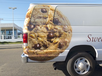 Vinyl wrapped car with image of a cookie on the side of the car