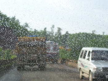 Raindrops on the windshield of a car