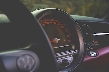 Close-up of car's speedometer and dashboard